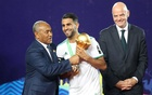 Africa Cup of Nations 2019 - Final - Senegal v Algeria - Cairo International Stadium, Cairo, Egypt - July 19, 2019 Algeria's Riyad Mahrez receives the trophy from CAF President Ahmad Ahmad after winning the Africa Cup of Nations as FIFA President Gianni Infantino looks on REUTERS/Suhaib Salem