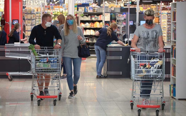 People wearing face masks leave a supermarket, after the federal state of North Rhine-Westphalia decided to make wearing protective masks obligatory in shops and public transportation to fight the spread of the coronavirus disease (COVID-19), in Bad Honnef near Bonn, Germany, April 27, 2020. REUTERS