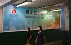Women walk past a government-sponsored advertisement promoting the new national security law as a meeting on national security legislation takes place in in Hong Kong, China June 29, 2020. REUTERS/Tyrone Siu
