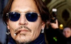 Actor Johnny Depp leaves the High Court in London, Britain, Feb 26, 2020. REUTERS/FILE