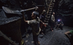 Child miners shovel coal at a mine in Khliehriat, India, Jan 21, 2013. The New York Times
