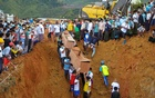 Volunteers carry coffins containing bodies of victims following a landslide at a mining site in Hpakant, Kachin State City, Myanmar July 3, 2020. Reuters
