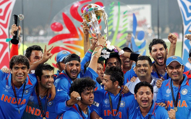 India's players celebrate with their trophy after India won their ICC Cricket World Cup final match against Sri Lanka in Mumbai April 2, 2011. REUTERS/Vivek Prakash