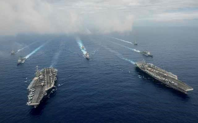 The Nimitz-class aircraft carriers USS John C. Stennis (CVN 74), and USS Ronald Reagan (CVN 76) (R) conduct dual aircraft carrier strike group operations in the US 7th Fleet area of operations in support of security and stability in the Indo-Asia-Pacific in the Philippine Sea on June 18, 2016. Courtesy Jake Greenberg/US Navy/Handout via REUTERS