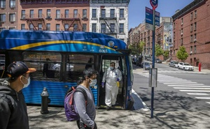 FILE -- Raymond Sanchez, a Metropolitan Transportation Authority driver, disinfects buses during the changing of shifts in East Harlem in New York on May 5, 2020. (Brittainy Newman/The New York Times)