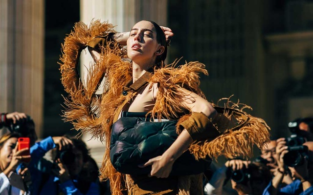 FILE -- Teddy Quinlivan on the street after walking in the Maison Margiela spring show in Paris on Sep 26, 2019. Now that fashion shows have gone digital and largely unemployed, a scattering of men and women describe their lives in the absence of shows. (Acielle Tanbetova/The New York Times)