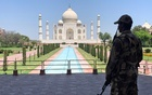 A member of Central Industrial Security Force stands guard inside the empty premises of the historic Taj Mahal during a 21-day nationwide lockdown in Agra, India, on Apr 2. REUTERS/FILE