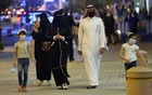 FILE PHOTO: A Saudi family wearing protective face masks walk on Tahlia Street as nightlife kicks off, after the government loosened lockdown restrictions following the outbreak of the coronavirus disease (COVID-19), in Riyadh, Saudi Arabia June 21, 2020. Picture taken June 21, 2020. REUTERS