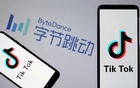 FILE PHOTO: TikTok logos are seen on smartphones in front of a displayed ByteDance logo in this illustration taken Nov 27, 2019. REUTERS
