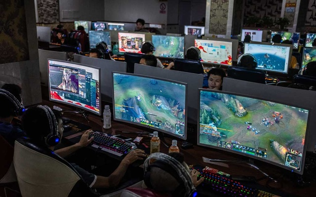 FILE -- People play video games at an internet cafe in Wenzhou, China, June 6, 2019. A battle involving Michael Pack, the new chief executive of the U.S. Agency for Global Media, and a U.S.-funded tech group revolves around software from Falun Gong, the secretive, anti-Beijing spiritual movement with pro-Trump elements. (Lam Yik Fei/The New York Times)