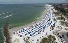 Sun seekers gather at Clearwater Beach, which remains open despite high numbers of coronavirus disease (COVID-19) infections in the state, on Independence Day in Clearwater, Florida, US July 4, 2020. REUTERS