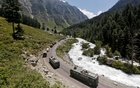 An Indian Army convoy moves along a highway leading to Ladakh, at Gagangeer in Kashmir's Ganderbal district Jun 18, 2020. REUTERS