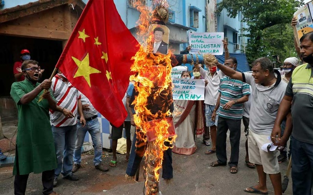 Demonstrators shout slogans as they burn an effigy depicting Chinese President Xi Jinping during a protest against China, in Kolkata, India, June 18, 2020. REUTERS