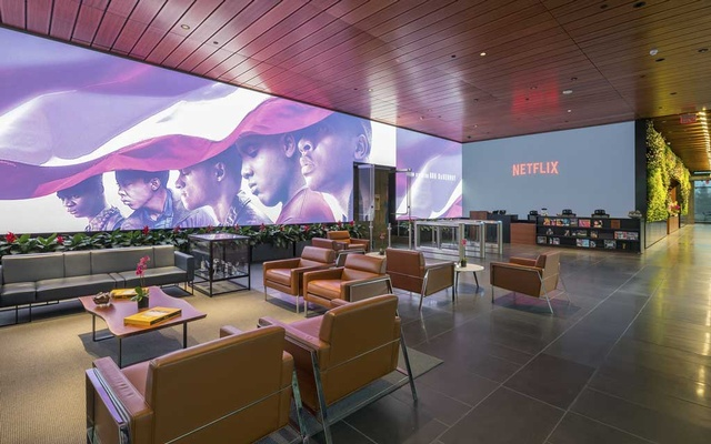 """FILE -- A promotional image for """"When They See Us,"""" Ava DuVernay's mini-series on the false convictions of the Central Park Five, in the lobby of the Netflix offices in Los Angeles, June 26, 2019. """"Netflix doesn't have to trot out the one or two things, but it has a library that's a wide cross section of taste and content that speaks to the understating of that audience,"""" said DuVernay, who is producing a new scripted Netflix series on the former National Football League quarterback Colin Kaepernick. (Hunter Kerhart/The New York Times)"""