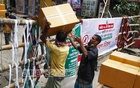 The traders transferring goods over the makeshift barricade erected at the entry of Old Dhaka's Wari amid the lockdown enforced in the area for 21 days to stop the spread of coronavirus outbreak.