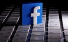 A 3D-printed Facebook logo is seen placed on a keyboard in this illustration taken Mar 25, 2020. REUTERS