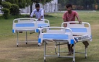 Workers push beds to an under-construction high dependency unit at a coronavirus disease care centre for patients inside an indoor sports complex, amid the spread of the disease, in New Delhi, on Jul 6. REUTERS