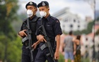 Malaysian police officers wear protective masks while they stand guard outside National Palace, following the outbreak of a new coronavirus in China, in Kuala Lumpur, Malaysia, Feb 10, 2020. REUTERS