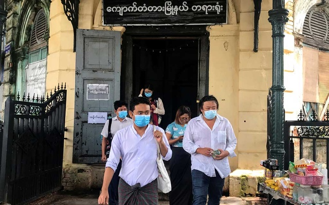 Youth activist Maung Saung Kha, (C), leaves at a court in Yangon, Myanmar, Jul 7, 2020. REUTERS