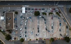 Vehicles line up at a coronavirus testing site in Austin, Texas, July 2, 2020. New technologies, like the gene-editing tool Crispr, can spot the virus in less than an hour — but it will likely be months before these tests hit clinics. (Tamir Kalifa/The New York Times)