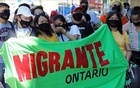 Migrants, refugees, undocumented workers and their supporters rally outside the office Canada's Immigration Minister Marco Mendicino in Toronto, Ontario, Canada Jul 4, 2020. REUTERS