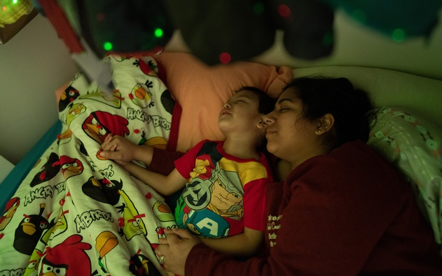 Rebecca Trimble prays with her boys during bedtime, in Bethel, Alaska, March 8, 2020. (Ash Adams/The New York Times)