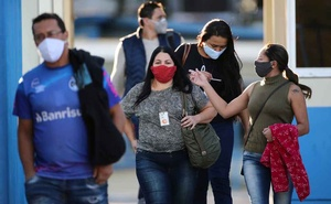 Employees leave JBS SA's poultry factory after the company was hit by an outbreak of the coronavirus disease (COVID-19), in Passo Fundo, state of Rio Grande do Sul, Brazil, April 24, 2020. REUTERS