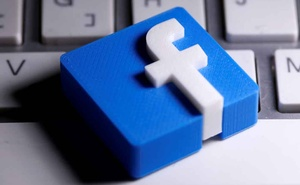 A 3D-printed Facebook logo is seen placed on a keyboard in this illustration. REUTERS