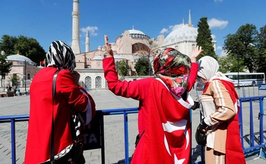A woman gestures in front of the Hagia Sophia or Ayasofya, after a court decision that paves the way for it to be converted from a museum back into a mosque, in Istanbul, Turkey, July 10, 2020. Reuters