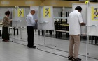 Voters fill in their ballots at a polling station, during a time band allocated to seniors and elders as part of preventive measures against the coronavirus disease (COVID-19) outbreak, in Singapore July 10, 2020. REUTERS