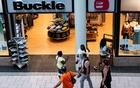 People walk in front of the Buckle store at the Destiny USA mall during the reopening, as the coronavirus restrictions are eased, in Syracuse, New York, on Jul 10. REUTERS