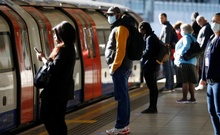 Commuters, some wearing masks are seen at Canning Town station, following the outbreak of the coronavirus disease (Covid-19), London, Britain, May 13, 2020. REUTERS/Henry Nicholls