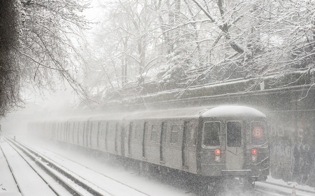 In a photo from the Metropolitan Transportation Authority, a B train runs during accumulation of 8 inches of snow in New York, March 5, 2015. Patrick Cashin via The New York Times