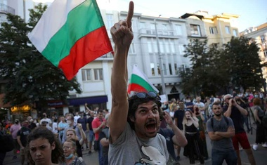 A man shouts slogans during a demonstration in front of the Court of Justice after prosecutors raided the Bulgarian president's offices as part of investigations, in Sofia, Bulgaria, July 9, 2020. REUTERS