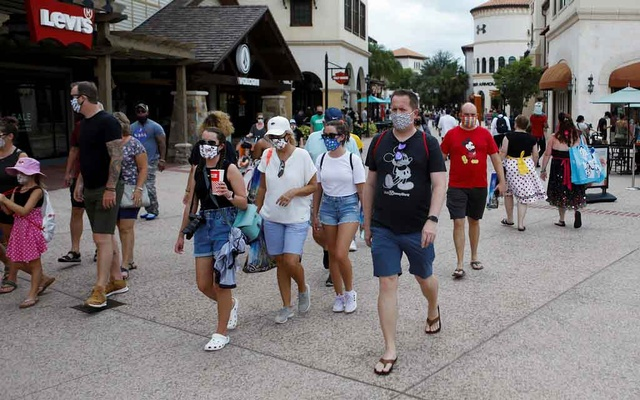 Disney Springs shoppers wear face masks and Disney-themed clothing while Walt Disney World conducts a phased reopening from coronavirus disease (COVID-19) restrictions in Lake Buena Vista, Florida, US July 11, 2020. REUTERS