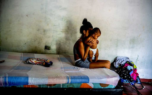 A 17-year-old with her child before heading to a park where she began working as a prostitute after her father lost his job due to the economic impact of the coronavirus, Cucuta, Colombia, May 22, 2020. The New York Times