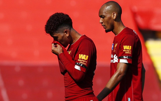 Premier League - Liverpool v Burnley - Anfield, Liverpool, Britain - July 11, 2020 Liverpool's Roberto Firmino and Fabinho after the match, as play resumes behind closed doors following the outbreak of the coronavirus disease (COVID-19) Pool via REUTERS
