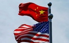 FILE PHOTO: Chinese and US flags flutter near The Bund, before US trade delegation meet their Chinese counterparts for talks in Shanghai, China July 30, 2019. REUTERS