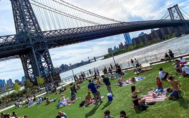 People try to keep social distance as they enjoy a warm afternoon during the outbreak of the coronavirus disease (COVID-19) at Domino Park in Brooklyn, New York, US, May 16, 2020. Reuters