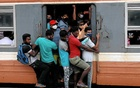 Passengers wearing protective masks travel on an overcrowded train towards capital city, amid concerns about the spread of the coronavirus disease (COVID-19), in Colombo, Sri Lanka, July 8, 2020. Reuters