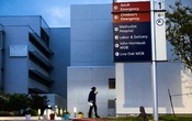 "FILE -- A health care worker arrives at Methodist Hospital in San Antonio, June 28, 2020. A 30-year-old man who believed the coronavirus was a hoax and attended a ""Covid party"" died after being infected with the virus, according to a Texas hospital. (Christopher Lee/The New York Times)"