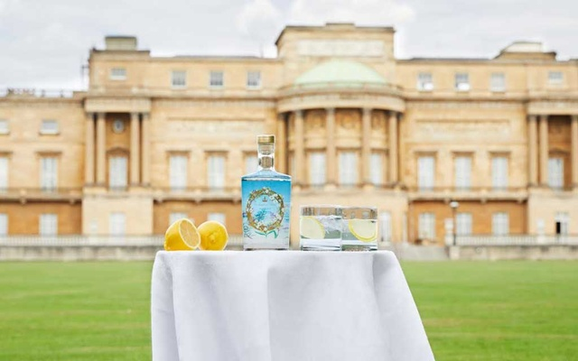 A bottle of small-batch dry gin by the Royal Collection Trust, a spirit infused with lemon, verbena, hawthorn berries and mulberry leaves collected from Queen Elizabeth II's gardens at Buckingham Palace, is seen outside of the Buckingham Palace in this undated handout picture. Royal Collection Trust/Her Majesty Queen Elizabeth II, 2020/Handout via REUTERS