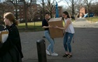 Students at Harvard University carry boxes in Cambridge, Mass, Mar 11, 2020. One after the other, like dominoes, colleges announced that because of coronavirus fears, they were suspending classes and asking students to pack up and go. Katherine Taylor/The New York Times
