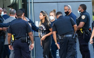 Detectives escort a woman from the building where Fahim Saleh was found dismembered. The New York Post