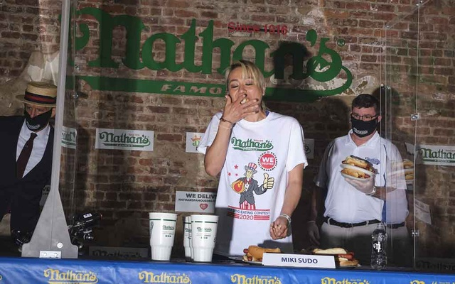 Miki Sudo competes during the women's Nathan's Famous Fourth of July hot dog eating contest in New York, Jul 4, 2020. John Taggart/The New York Times