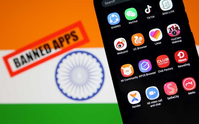 Smartphone with Chinese applications is seen in front of a displayed Indian flag and a
