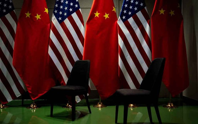 FILE -- The flags of the United States and China at the site of a bilateral meeting between President Donald Trump and China's leader, Xi Jinping, at the Group of 20 summit in Osaka, Japan, on June 29, 2019. As the U.S. and China clash over technology, territory and clout, a new geopolitical era is dawning. (Erin Schaff/The New York Times)