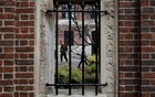 Students and pedestrians walk through the Yard at Harvard University, after the school asked its students not to return to campus after Spring Break and said it would move to virtual instruction for graduate and undergraduate classes, in Cambridge, Massachusetts, US, March 10, 2020. REUTERS