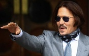 Actor Johnny Depp reacts as he arrives at the High Court in London, Britain July 16, 2020. REUTERS