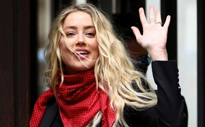 Actor Amber Heard gestures as she arrives at the High Court in London, Britain July 16, 2020. REUTERS